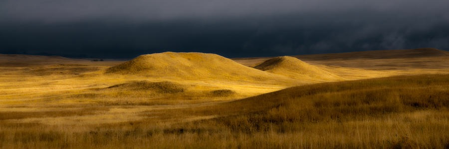 Pic 1. storm-clouds-over-the-prairie-badlands-national-park-ron-mcginnis