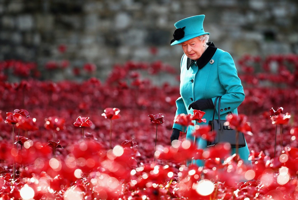 Pic 6. Queen Loitering- Britain's Queen Elizabeth II visits the Tower of London's 'Blood Swept Lands and Seas of Red' poppy installation in central London on October 16, 2014