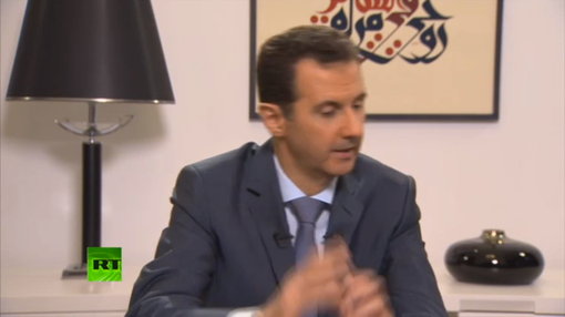 Pic 7. Assad's ISIS Interview, 'West Crying for Refugees with One Eye, Aiming Gun with the Other''